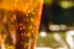 Close-up photo with glass of light beer Royalty Free Stock Images