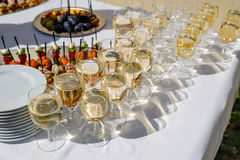 Close up photo with glasses of champagne on festive table Stock Images