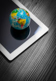 close up photo of globe on tablet computer. mobile internet concept Stock Photos