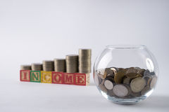 Close-up photo with golden coins in Piggy bank Royalty Free Stock Photography