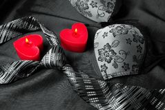 Close-up photo of gray men`s tie and women`s bra. Prelude of love. Romantic evening Stock Image