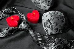 Close-up photo of gray men`s tie and women`s bra. stock image