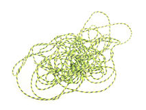 Close up photo of green string or twine on a white background Stock Photo