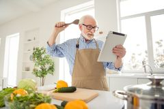 Close up photo grey haired he his him grandpa hands arms e-reader sorry guilty face wrong ingredient afraid scared of. Consequences wear specs casual checkered royalty free stock photos