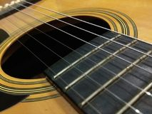Close up photo of a guitar. And some string on it Royalty Free Stock Photos