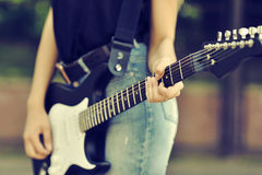 Close up photo of guitar female player Royalty Free Stock Photos