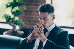 Close up photo handsome he him his pensive ponder hmm hands arms fingers together not smiling attentive self-confident royalty free stock photos