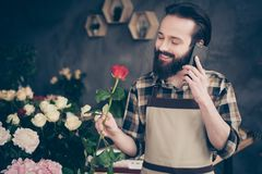 Close up photo handsome trendy charming small business representative stylish hold hand device gadget positive cheerful. Enjoy rest relax, look scent rejoice stock image