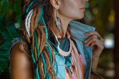 close up photo of hippie girl wearing denim jacket with dreadlock tresses stock photos