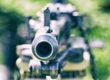 Close up photo of historical loaded machine gun, cold photo filt Stock Photos