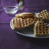 Homemade waffles with honey. Close up photo of homemade waffles with honey Royalty Free Stock Photography