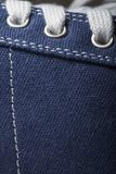 Close-up photo of jeans Sneakers texture background.  Stock Images