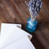 Close-up photo of light pink scheduler notebook on a wooden table with lavender. Flat lay composition Stock Image