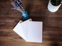Close-up photo of light pink scheduler notebook on a wooden table with lavender. Flat lay composition Stock Photography