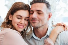 Close up photo of lovely couple man and woman hugging and taking Stock Image