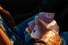 Close-up photo of male hand holding a wads of money Royalty Free Stock Photo