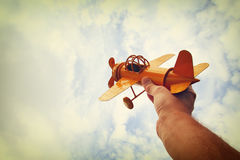 close up photo of man's hand holding retro airplane royalty free stock photos