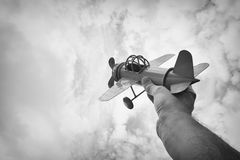 close up photo of man's hand holding retro airplane Royalty Free Stock Image