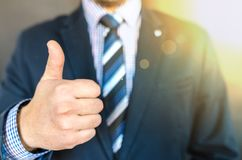 Close-up Photo of Man Wearing Black Suit Jacket Doing Thumbs Up Gesture Royalty Free Stock Photos