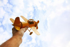 Close up photo of man& x27;s hand holding toy airplane Stock Photos