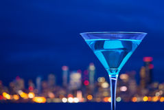 Close-up photo of martini cup against city lights Royalty Free Stock Photo