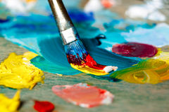 Close up photo of mixing oil paints on palette. Stock Images
