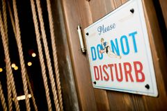 Nameplate `Please, DO NOT DISTURB`. Close-up photo nameplate ` Pleas, DO NOT DISTURB Royalty Free Stock Image