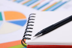 Close-up photo of a notebook and pen Stock Photography