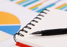 Close-up photo of a notebook and pen Stock Images