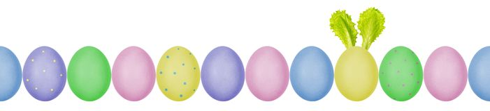 Free Close Up Photo Of Colorful Painted Easter Eggs With Eggshell Texture In A Row. One Egg With Bunny Ears Made Of Salad Leaves Royalty Free Stock Photos - 143035048