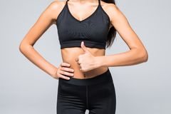 Free Close Up Photo Of Perfect Fit Slim Woman`s Belly And Thumb Up On Gray Background Stock Photo - 130418440