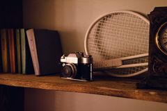 Close up photo of old camera lens over wooden shelf stock images