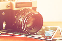 Close up photo of old camera lens over wooden table. image is retro filtered. selective focus Royalty Free Stock Photos