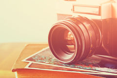 Close up photo of old camera lens over wooden table. image is retro filtered. selective focus.  royalty free stock images