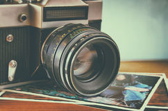 Close up photo of old camera lens over wooden table. image is retro filtered. selective focus Stock Images