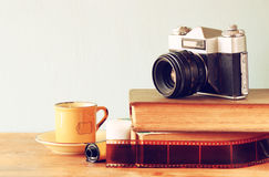 Close up photo of old camera lens over wooden table. image is retro filtered. selective focus.  stock photography