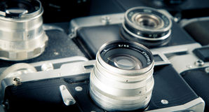 Close-up photo old cameras background Royalty Free Stock Photos
