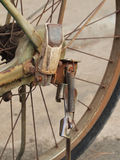 Close up photo of old, dirty and rusty bicycle chains, sprocket and foot peg at rear wheel. Stock Image