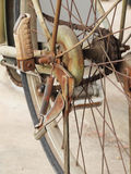 Close up photo of old, dirty and rusty bicycle chains, sprocket and foot peg at rear wheel. Stock Images