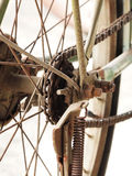 Close up photo of old, dirty and rusty bicycle chains with sprocket at rear wheel. Royalty Free Stock Photo