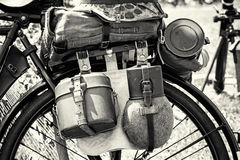 Close up photo of old military bicycle with equipment, black and Stock Photos