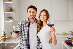 Close up photo pair beautiful he him his macho guy she her lady birthday just married bonding hands arms red wine royalty free stock image