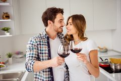 Close up photo pair beautiful he him his macho guy she her lady birthday just married bonding hands arms red wine royalty free stock photography