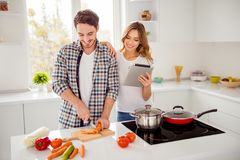 Close up photo pair beautiful he him his macho she her lady e-book e-reader electronic cook book overjoyed making first royalty free stock photo