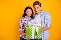 Close up photo of pair hugging he him his she her lady boy surprised took first party present shocked wearing casual. Plaid shirts outfit isolated on yellow royalty free stock photo