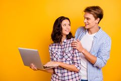 Close up photo of pair in love he him his she her lady boy with computer in hands best intentions looking for web stock image