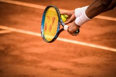 Close-Up Photo of Person Holding Tennis Racket and Ball stock photo