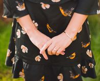 Close Up Photo of Person Wearing Black and Orange Floral Dress Stock Photography
