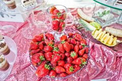 Close-up photo of a plate with fresh strawberries on wedding buf Stock Images