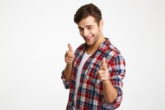 Close-up photo of playful shaven young man in checkered shirt po Stock Photo